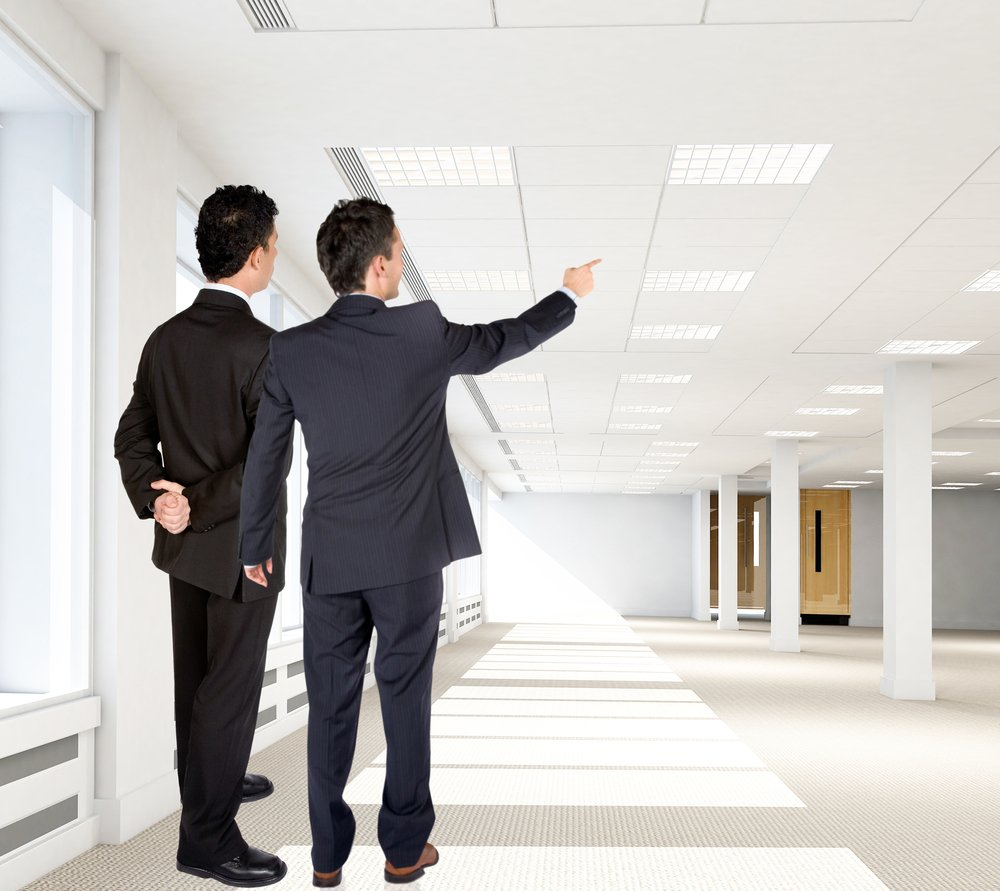 Business men at the new office pointing at something